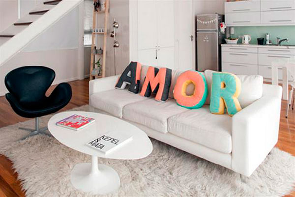 Decorate with cushions that are letters