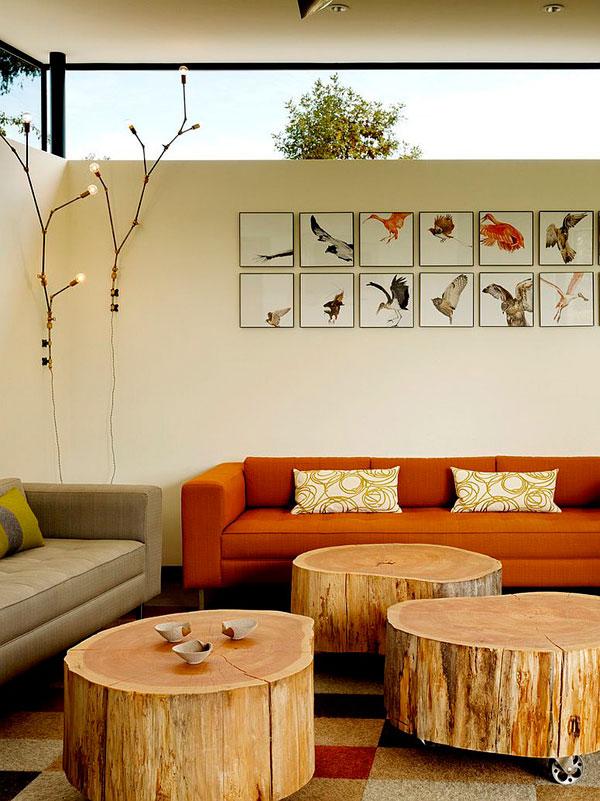 Troncos de árbol como mesas auxiliares de cafe con ruedas