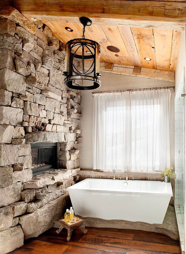 Baños de diseño rústico de piedra