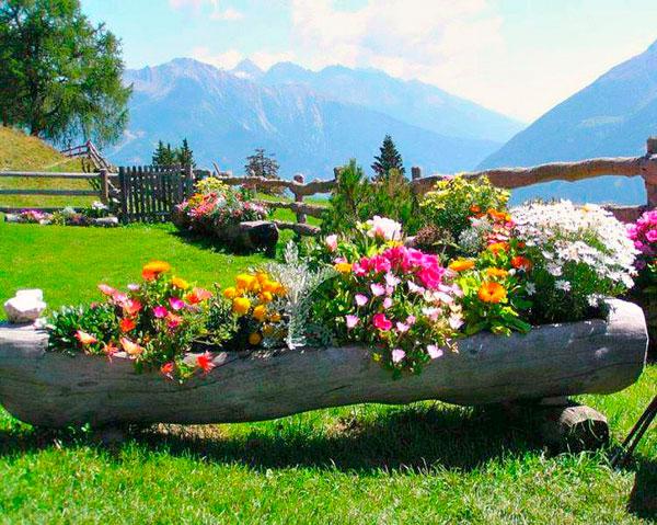 jardineras de madera con troncos de rbol