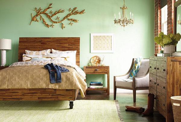 cama con una base madera y ruedas de metal
