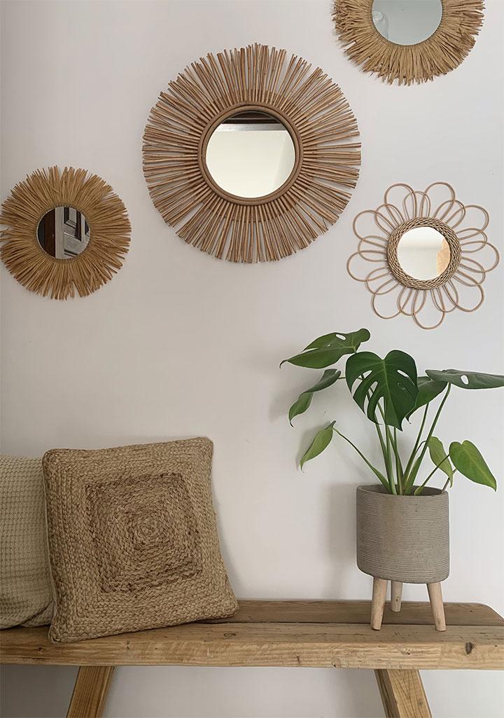 Espejos de sol de ratán para el recibidor