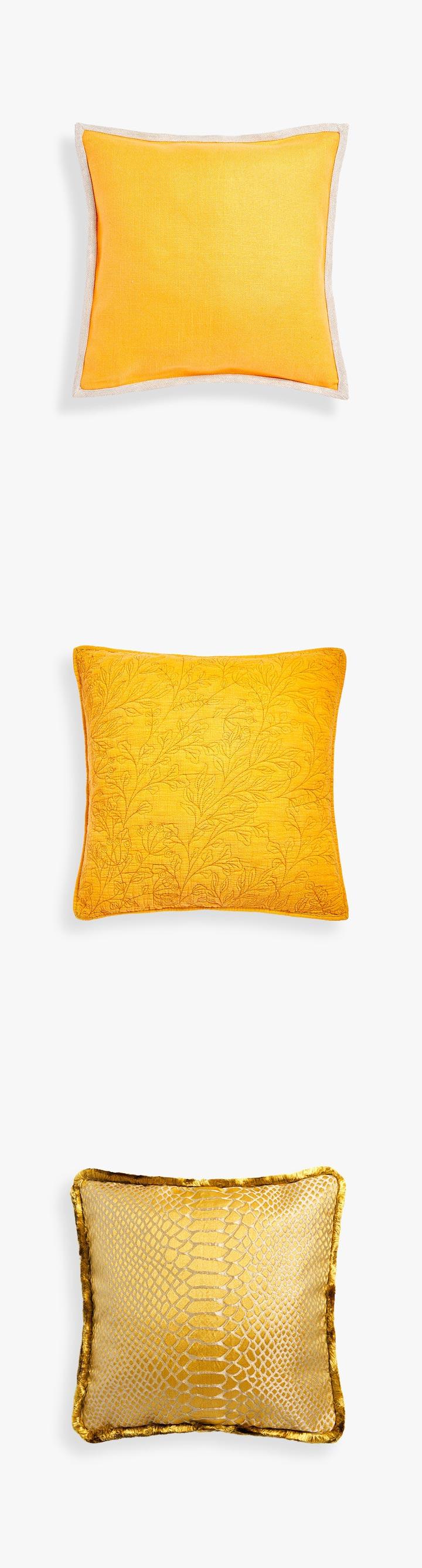 Cojines amarillos Zara Home sofá